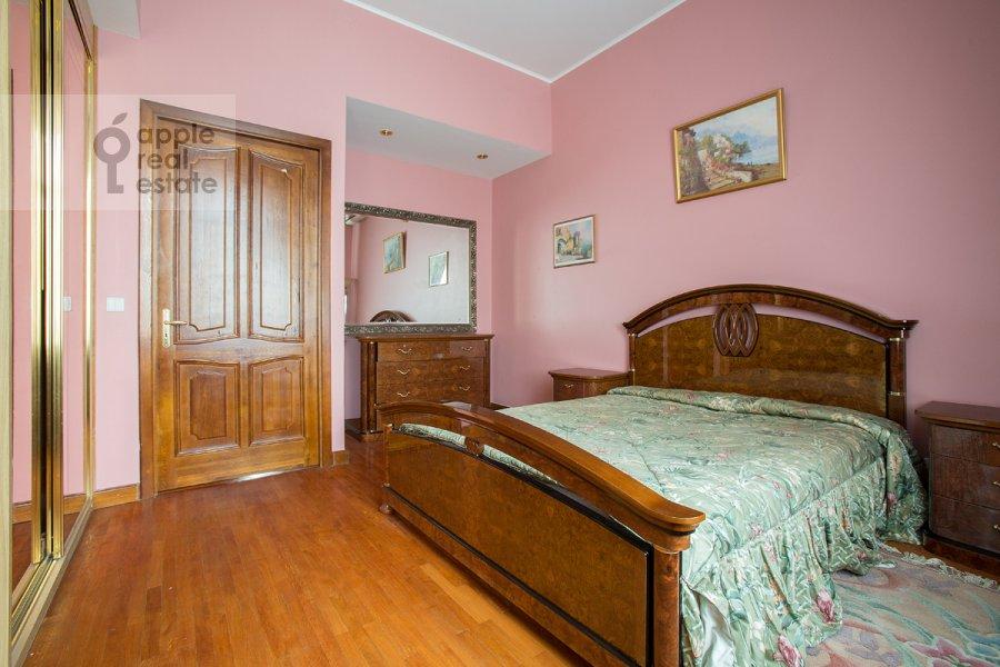 Bedroom of the 3-room apartment at Serafimovicha ul. 2